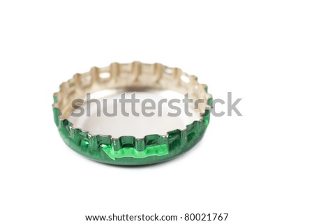 Closeup view of green bottle cap isolated over white - stock photo