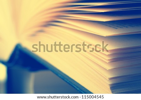 Closeup view of hardcover book. Toned - stock photo