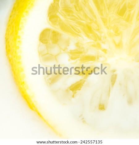 closeup view of lemon dipped in milk - stock photo