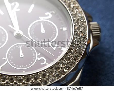 Closeup view of luxury woman's wristwatch. - stock photo
