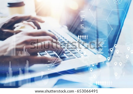 Closeup view of Male hand typing on laptop keyboard.Businessman working at office on modern notebook.Concept of digital diagram,graph interfaces,virtual screen,connections icon.Blurred