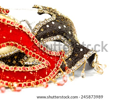 Closeup view of many carnival masks over white background