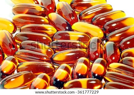 Closeup view of medication soft gel capsule.  - stock photo