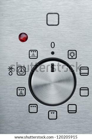 Closeup view of metallic handle of modern oven - stock photo