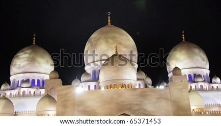 Closeup view of minarets of Sheikh Zayed Mosque which is also known as grand mosque in Abu Dhabi, UAE. - stock photo