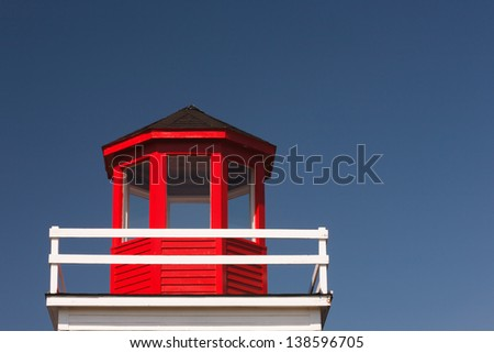 Closeup view of old lighthouse structure - stock photo