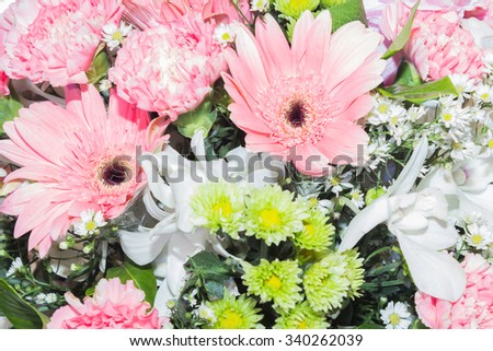 Closeup view of one beautiful fresh bright white yellow big wedding bouquet of rose flowers, vertical picture - stock photo