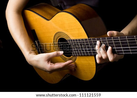 Closeup view of playing classic spanish guitar - stock photo