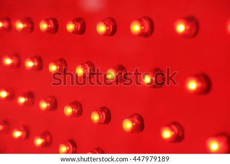 Closeup view of red color decorative LED light bulb.  - stock photo