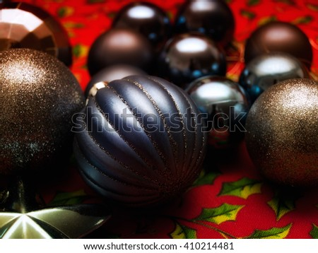 Closeup view of several dark Christmas balls.