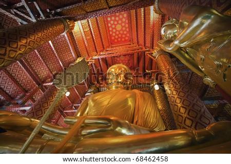 Closeup view of Sitting Buddha statue at the Buddhist temple Wat Phanan choeng in Autthaya near Bangkok, Thailand - stock photo