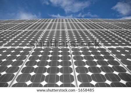 closeup view of solar panels on a blue sky background - stock photo