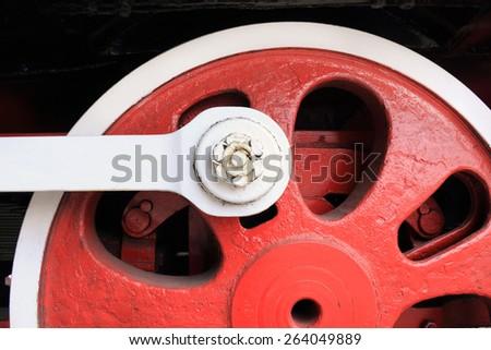 Closeup view of steam locomotive wheel - stock photo