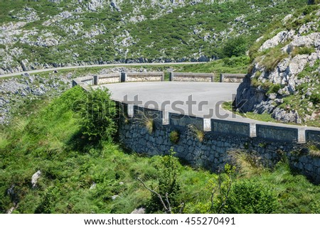 Closeup view of U-shape curved road in the mountain - stock photo