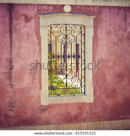 Closeup view of window with beautiful decorative protective lattice