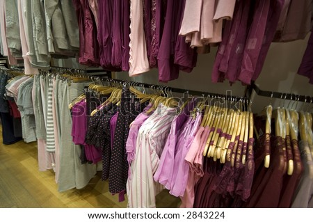 closeup view of womens clothes on a rack - stock photo
