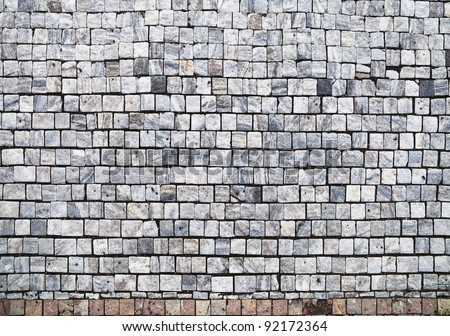 Closeup view on a cobblestone road - pattern - background - stock photo