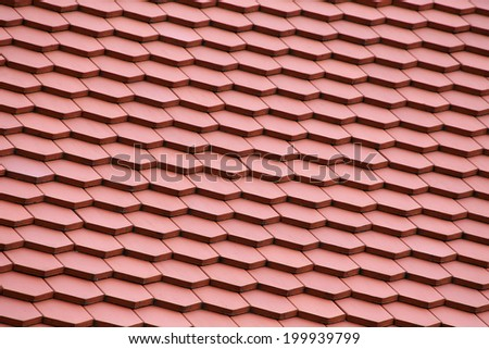 Closeup view on a Tile roof - pattern - background - stock photo