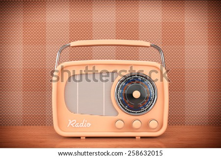 Closeup Vintage Radio on table front wall background - stock photo