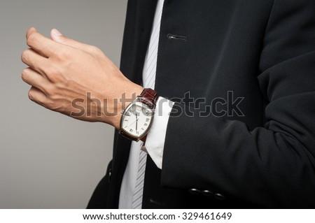 closeup vintage style of luxury men watch on businessman's wrist - stock photo
