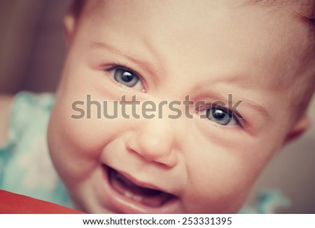 Closeup vintage style portrait of a crying baby, very sad cute little child, bad mood facial expression, whining behavior, unhappy childhood concept - stock photo