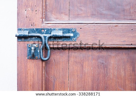 Closeup vintage wooden door locked , stock photo - stock photo