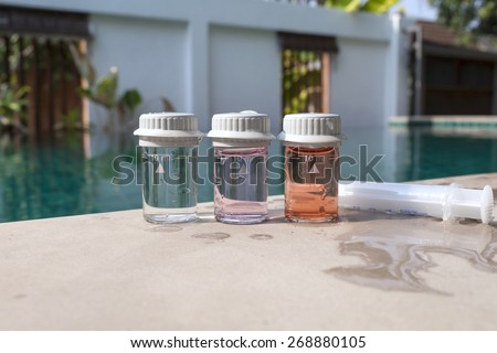 Closeup Water testing result on swimming pool edge - stock photo