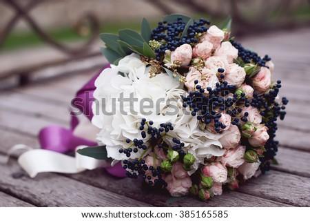 closeup wedding bride's bouquet. vintage wedding background - stock photo