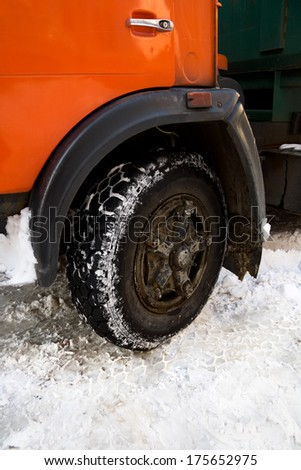 closeup wheel of a parked truck in winter  - stock photo