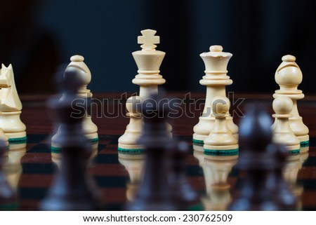 Closeup white king and queen Set of chess figures on the playing board - stock photo