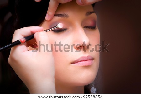 closeup with an eye brush makeup made by make up artist - stock photo