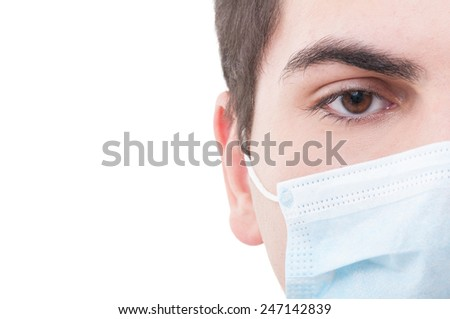 Closeup with the right eye of a doctor wearing medical mask - stock photo