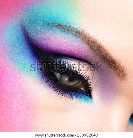 Closeup woman eyes with beautiful  fashion bright blue makeup - stock photo