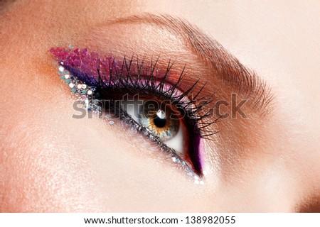 Closeup woman eyes with beautiful  fashion bright pink make-up - stock photo