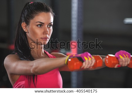 closeup woman face and dumbbells - stock photo