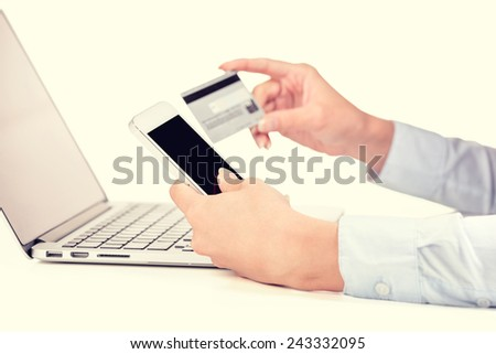 Closeup woman hands holding credit card using cell, smart phone computer for online shopping or reporting lost card, fraudulent transaction isolated on white background. New generation gadget concept