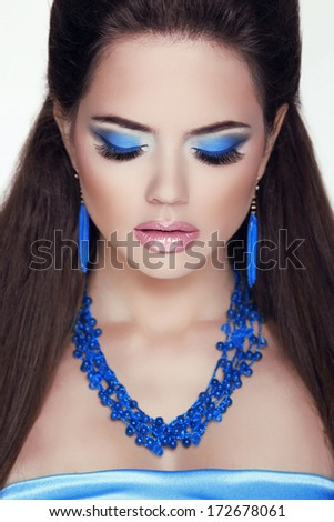 Closeup woman portrait. Jewelry. Eye makeup, professional visage. Attractive brunette girl. - stock photo