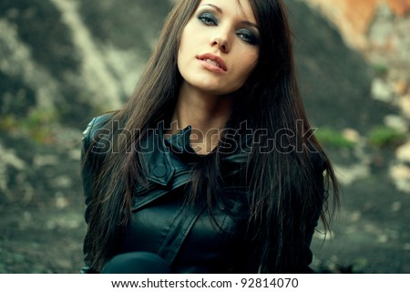 closeup woman portrait wearing black leather jacket - stock photo