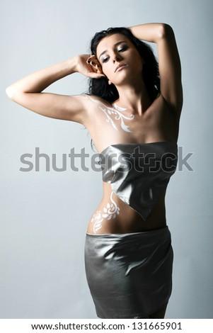Closeup woman portrait with body art - stock photo