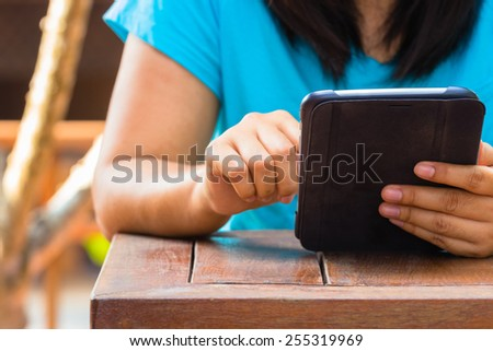 Closeup woman  using computer tablet outdoor - stock photo