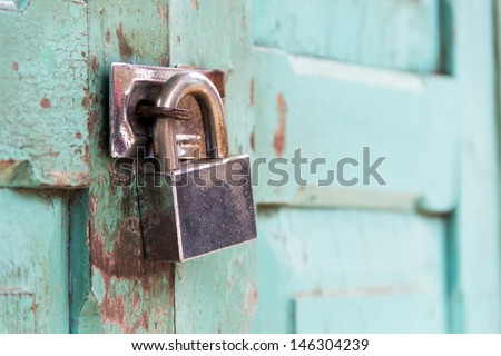 Closeup wooden door with lock - stock photo