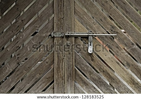 Closeup wooden door with lock in grungy style and good texture - stock photo