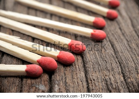 closeup wooden matches on wooden table - stock photo