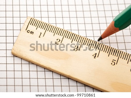 closeup wooden ruler and pencil on background - stock photo