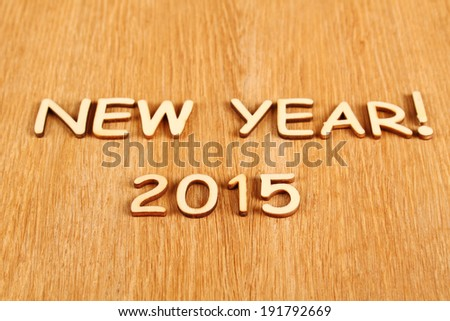 """Closeup wooden text """"New year 2015"""". Background - stock photo"""