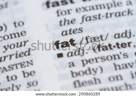 closeup word fat in dictionary, soft focus, - stock photo