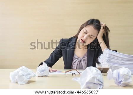 Closeup working woman stressed pile work stock photo 446565097 closeup working woman are stressed from pile of work paper in front of her in work publicscrutiny Images