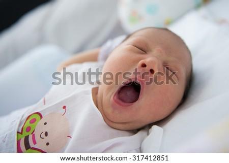 Closeup yawning baby - stock photo