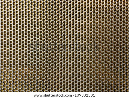 Closeup  yellow brass metal plate covered punched aluminum - stock photo