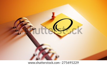Closeup Yellow Sticky Note paste it in a notebook setting an appointment. Circle mark written on a white notebook to remind you an important appointment. - stock photo